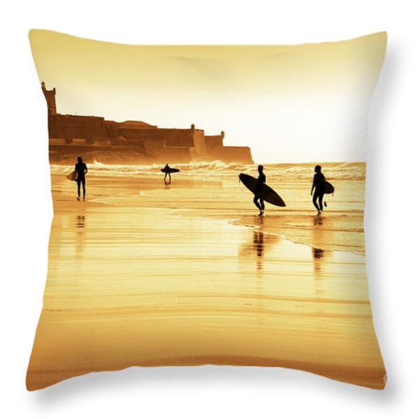 Surfers Silhouettes Throw Pillow by Carlos Caetano
