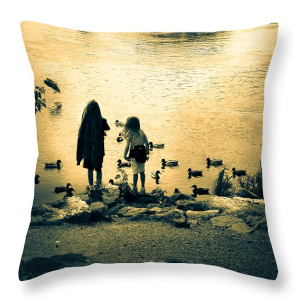 Talking to ducks Throw Pillow by Bob Orsillo
