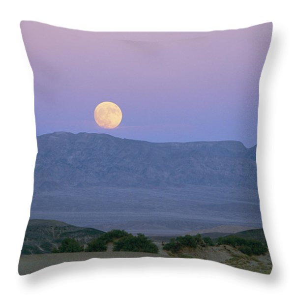 The Moon Rises Over The Amargosa Throw Pillow by Marc Moritsch