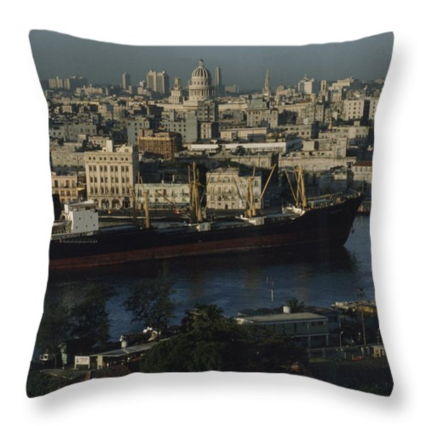 View Of City And A Massive Freighter Throw Pillow by James L. Stanfield