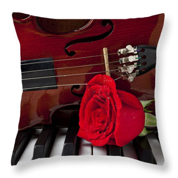 Violin and rose on piano Throw Pillow by Garry Gay