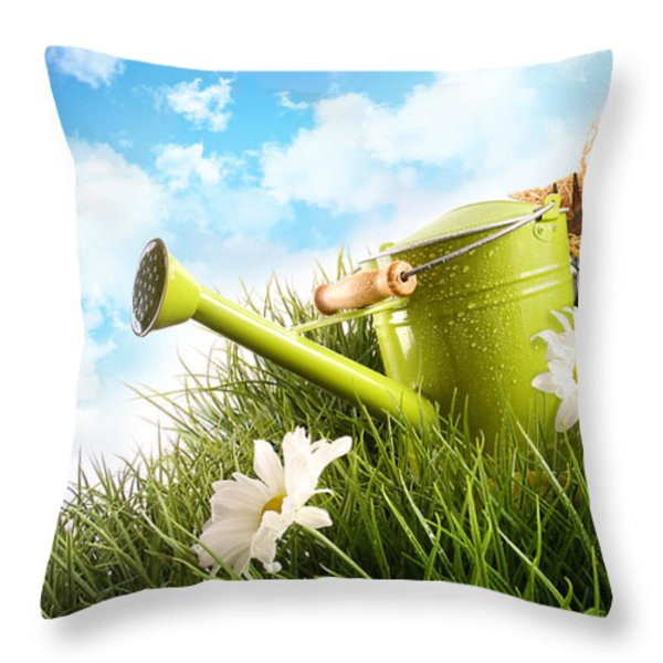 Water Can And Straw Hat Laying In Grass Throw Pillow by Sandra Cunningham
