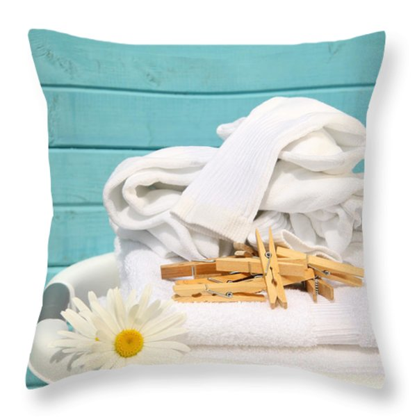 White  basket with laundry Throw Pillow by Sandra Cunningham