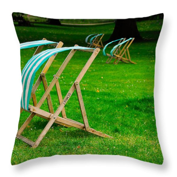 Windy Chairs Throw Pillow by Harry Spitz