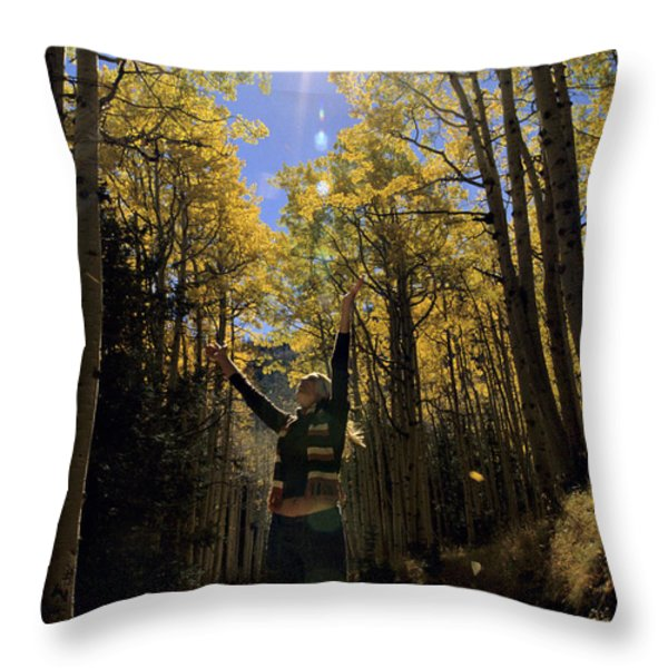Woman In The Falling Leaves Throw Pillow by Dawn Kish