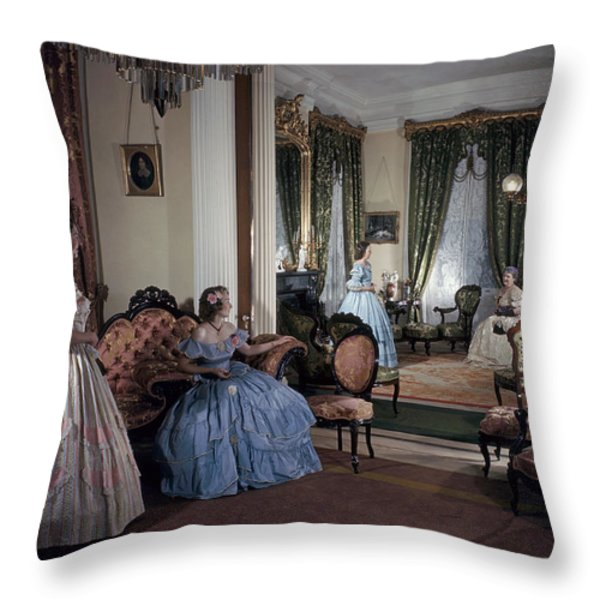 Women In Period Costumes Sit In An Throw Pillow by Willard Culver
