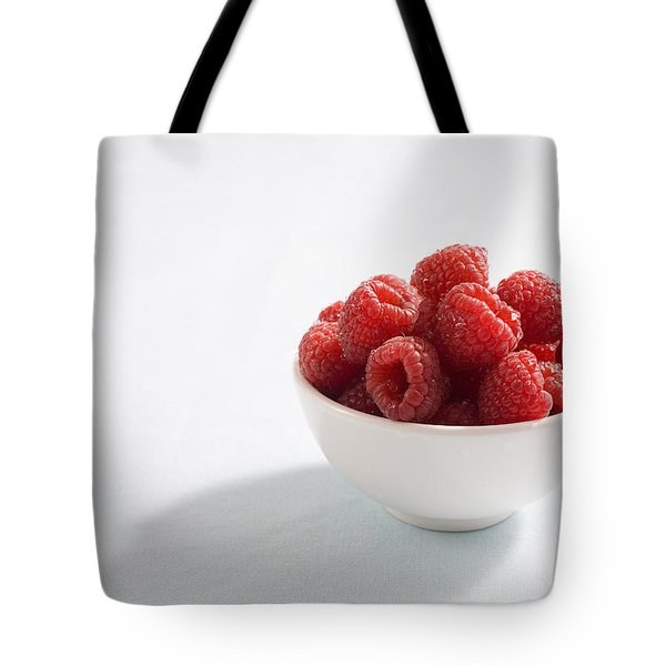 Bowl Of Raspberries Tote Bag by Greg Huszar Photography