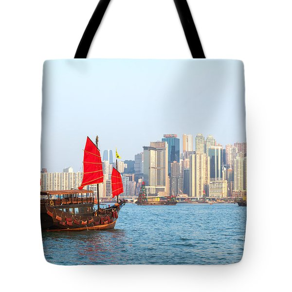 Chinese Junk Boat Sailing In Hong Kong Harbor Tote Bag by Matteo Colombo