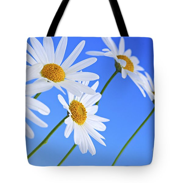 Daisy flowers on blue background Tote Bag by Elena Elisseeva