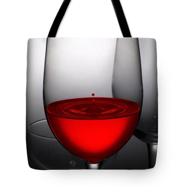 Drops Of Wine In Wine Glasses Tote Bag by Setsiri Silapasuwanchai