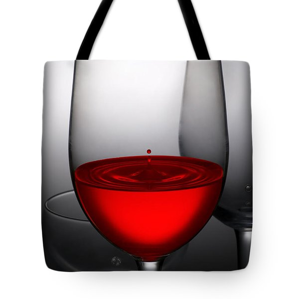drops of wine in wine glasses Tote Bag by Setsiri Silapasuwanchai