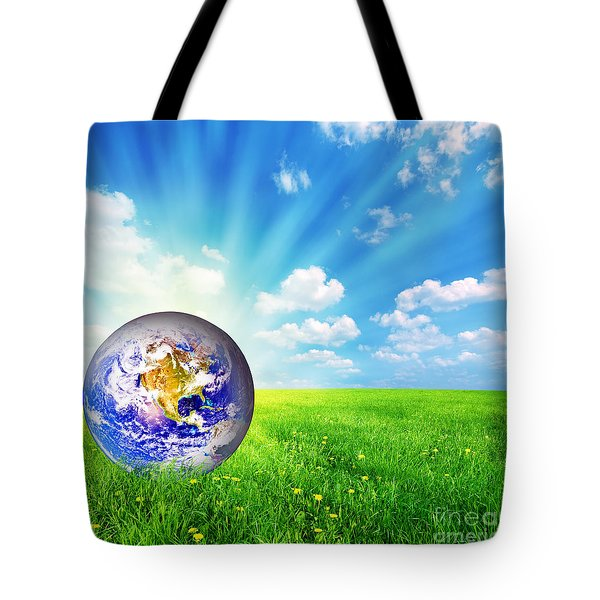 Earth Globe On Green Grass Tote Bag by Michal Bednarek