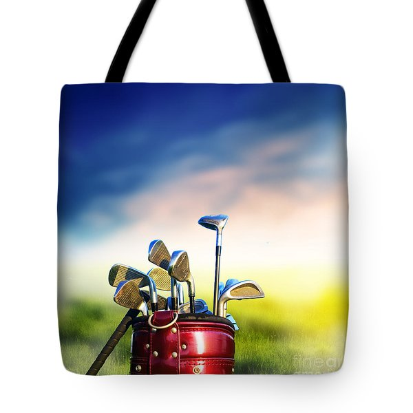 Football Soccer Ball On Green Grass Tote Bag by Michal Bednarek