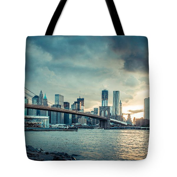 NYC skyline in the sunset v1 Tote Bag by Hannes Cmarits
