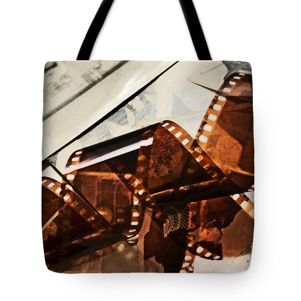 Old film strip and photos background Tote Bag by Michal Bednarek