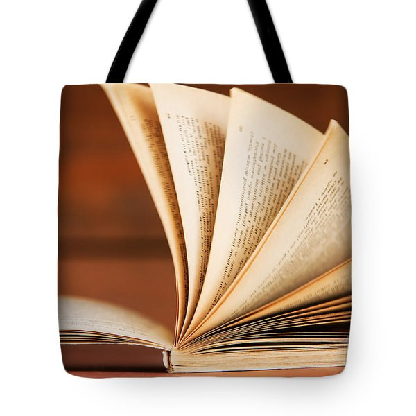Open book in retro style Tote Bag by Michal Bednarek