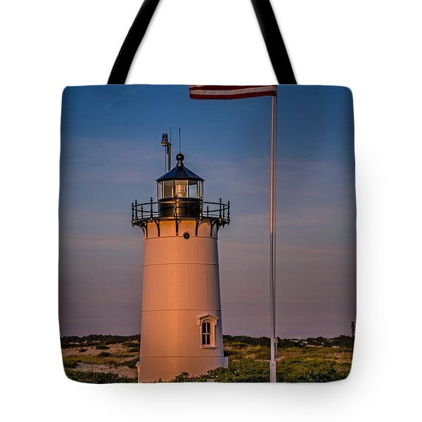 Race Point Lighthouse And Old Glory Tote Bag by Susan Candelario