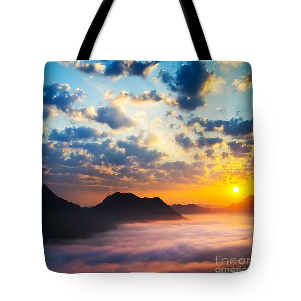 Sea of clouds on sunrise with ray lighting Tote Bag by Setsiri Silapasuwanchai