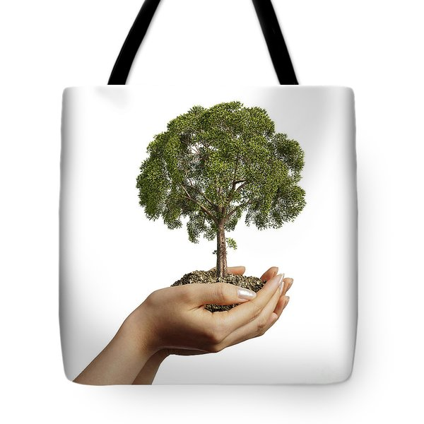 Womans Hands Holding Soil With A Tree Tote Bag by Leonello Calvetti
