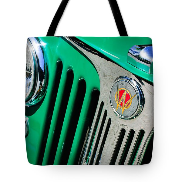 1949 Willys Jeep Station Wagon Grille Emblem Tote Bag by Jill Reger