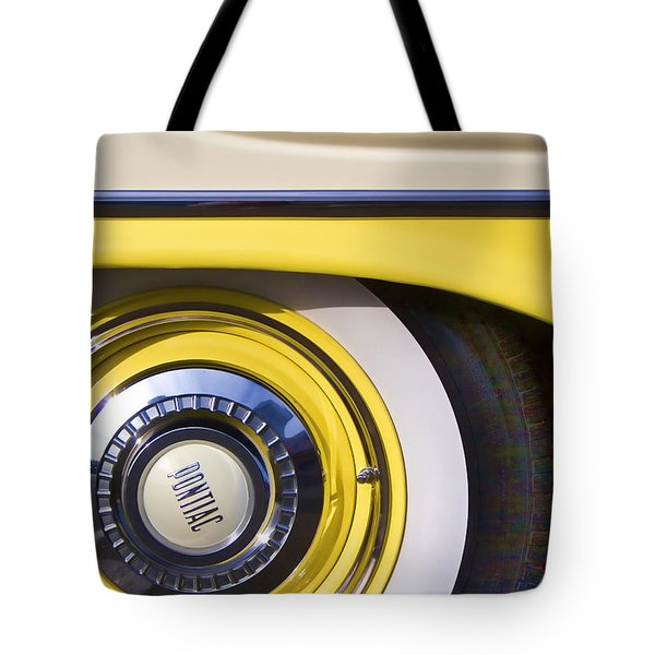 1957 Pontiac Starchief Wheel Cover Tote Bag by Carol Leigh