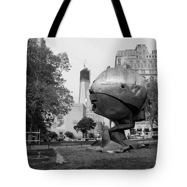 1w T C And The W T C Fountain Sphere In Black And White Tote Bag by Rob Hans