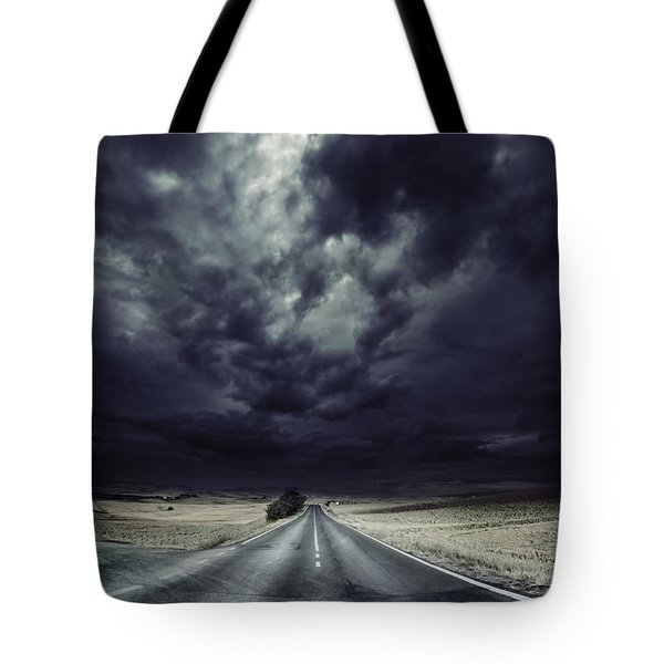 An Asphalt Road With Stormy Sky Above Tote Bag by Evgeny Kuklev