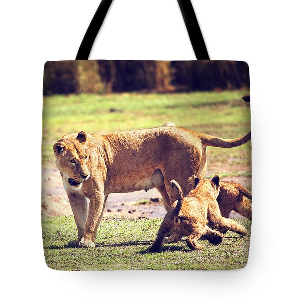 Small Lion Cubs With Mother. Tanzania Tote Bag by Michal Bednarek