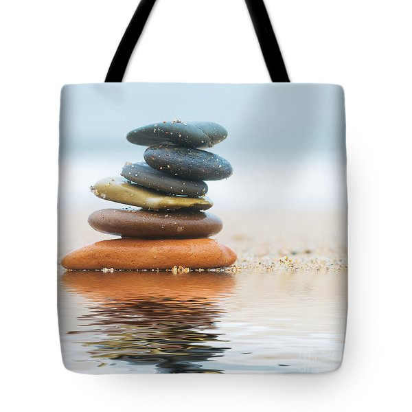 Stack Of Beach Stones On Sand Tote Bag by Michal Bednarek