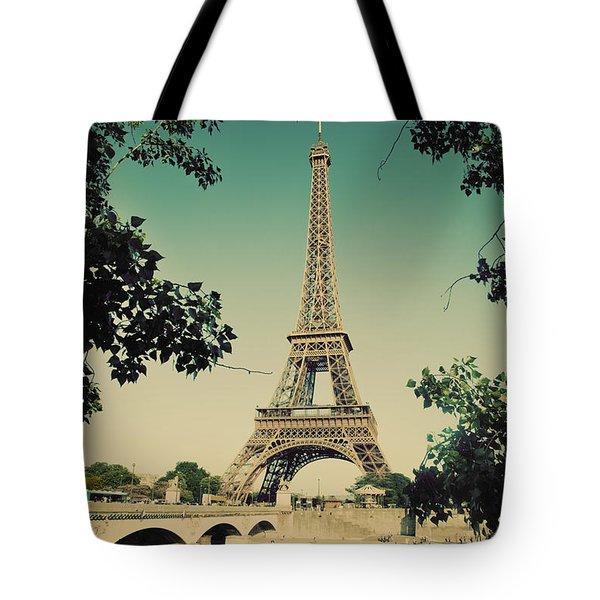 Eiffel Tower And Bridge On Seine River In Paris Tote Bag by Michal Bednarek