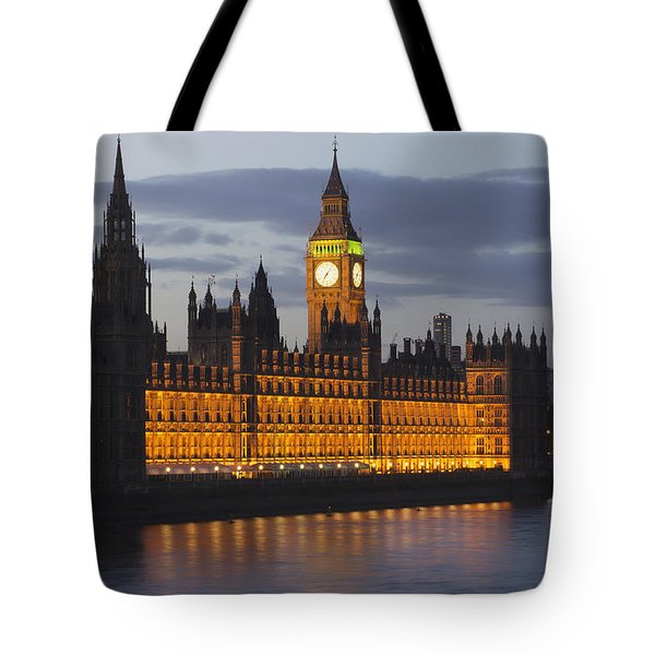 A Building And Clock Tower Along The Tote Bag by Charles Bowman