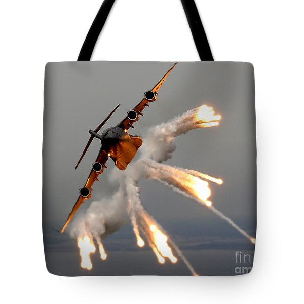 A C-17 Globemaster IIi Releases Flares Tote Bag by Stocktrek Images