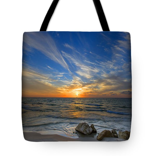 a majestic sunset at the port Tote Bag by Ron Shoshani
