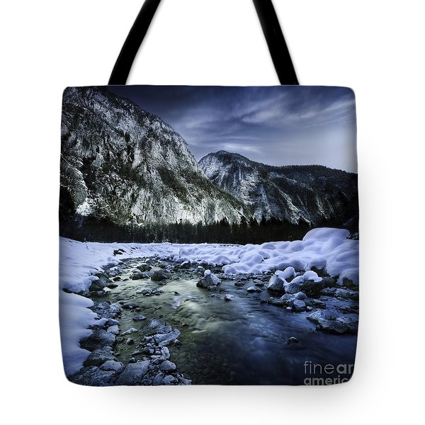 A River Flowing Through The Snowy Tote Bag by Evgeny Kuklev
