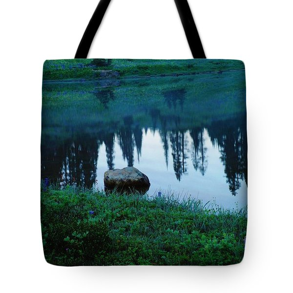A Rock In The Reflection Tote Bag by Jeff  Swan