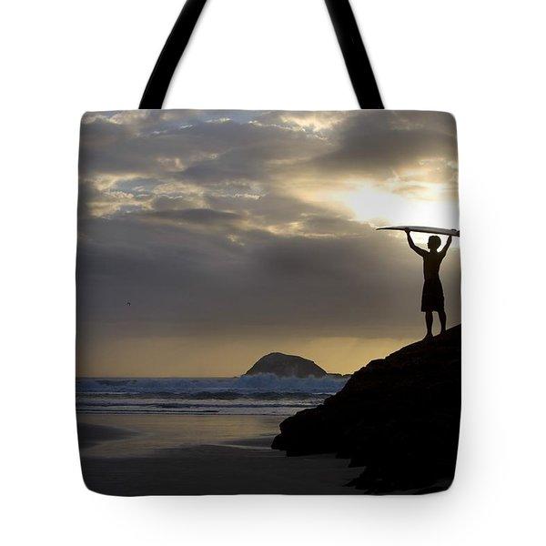 A Surfer On Muriwai Beach New Zealand Tote Bag by Deddeda
