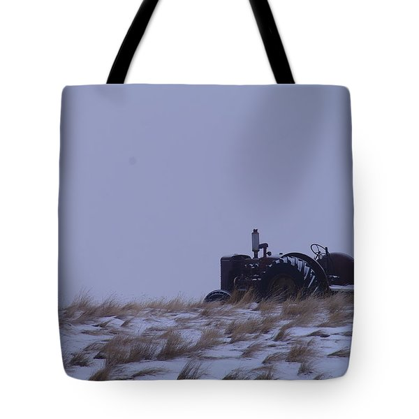 A Tractor Fading To The Snow  Tote Bag by Jeff Swan