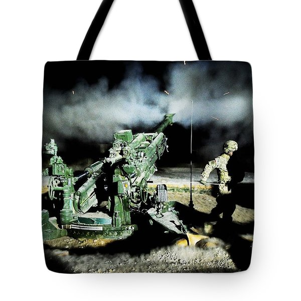A United States Gun Crew Fire Illumination Rounds At Forward Operating Base Hadrian Tote Bag by Paul Fearn