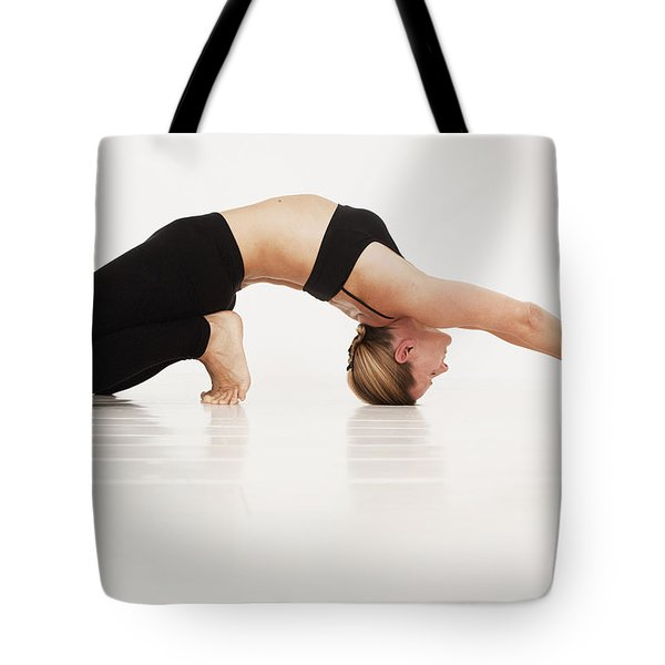 A Woman In A Yoga Pose Tarifa, Cadiz Tote Bag by Marcos Welsh