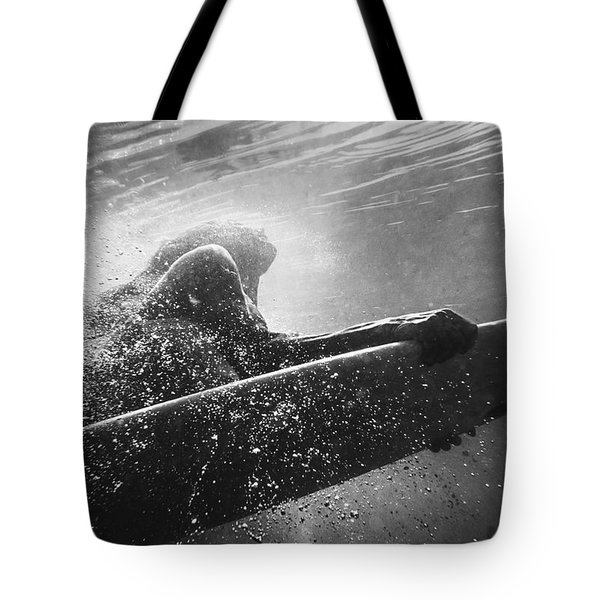 A Woman On A Surfboard Under The Water Tote Bag by Ben Welsh