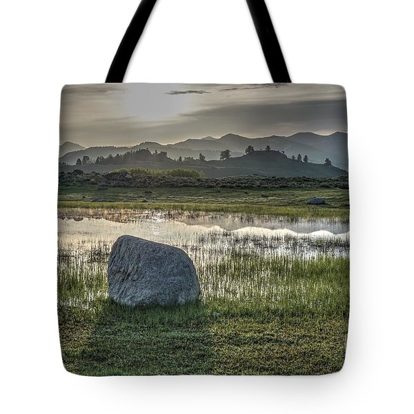 Tote Bag featuring the photograph A Yellowstone Sunrise And Hazy Morning Ridges by Bill Gabbert