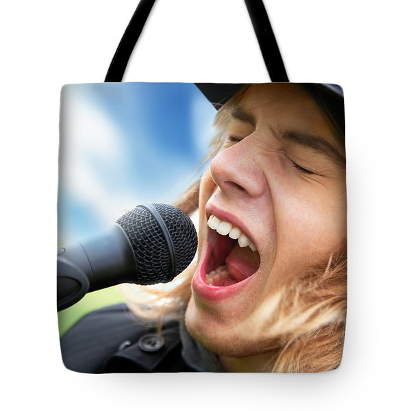 A Young Man Sings To A Microphone Tote Bag by Michal Bednarek