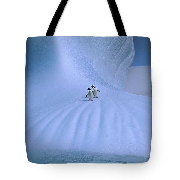 Adelie Penguins On Iceberg Antarctica Tote Bag by Peter Sinden