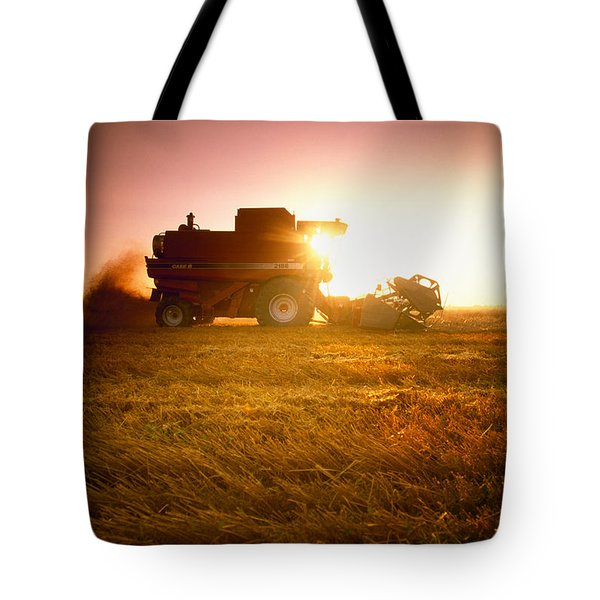 Agriculture - A Combine Harvests Wheat Tote Bag by Mirek Weichsel