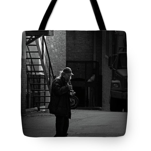 Alone In The Streets Tote Bag by Karol Livote