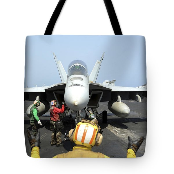 An Aircraft Director Signals Tote Bag by Stocktrek Images