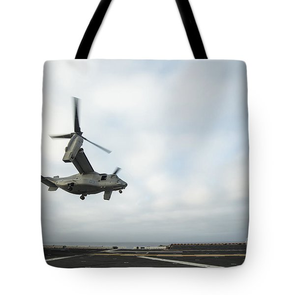 An Mv-22 Osprey Is Guided Onto Tote Bag by Stocktrek Images