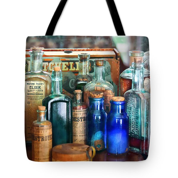 Apothecary - Remedies For The Fits Tote Bag by Mike Savad