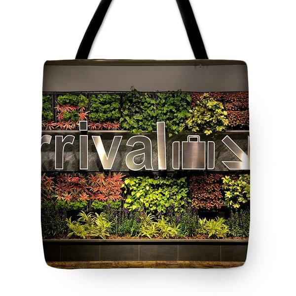 Arrival Sign Arrow And Flowers At Singapore Changi Airport Tote Bag by Imran Ahmed