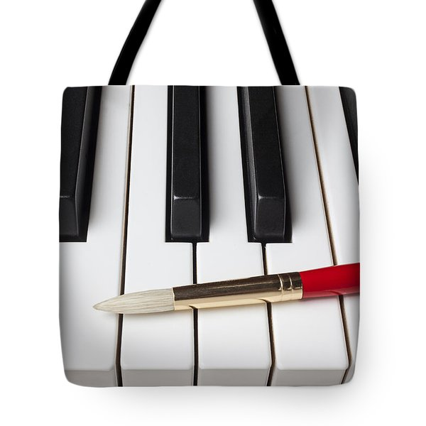 Artist brush on piano keys Tote Bag by Garry Gay